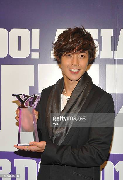 Actor and singer Kim Hyun Joong of South Korea poses with the trophy during the Yahoo Asia Buzz Awards 2010 at Hong Kong Convention and Exhibition...