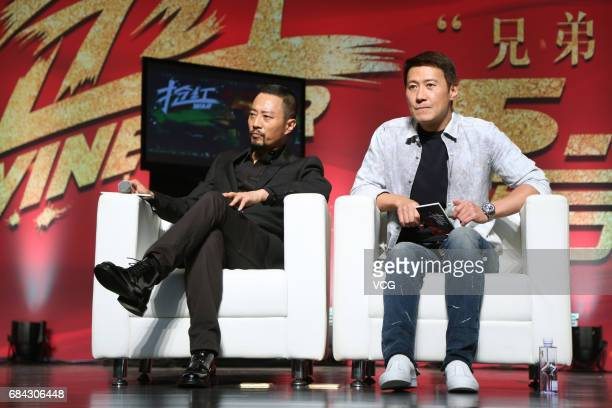Actor and singer Leon Lai and actor Zhang Hanyu promote film 'Wine War' at Beijing Foreign Studies University on May 17 2017 in Beijing China
