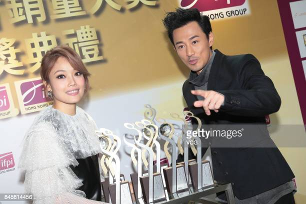 Actor and singer Raymond Lam and singer Joey Yung attend the award ceremony for IFPI's Best Selling Singers on September 11 2017 in Hong Kong China