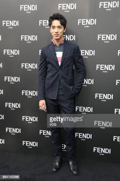 Actor and singer Xu Weizhou arrives at the red carpet of Fendi Peekaboo Exhibition on June 9 2017 in Beijing China