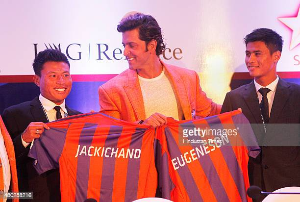 Actor and team owner of Pune City Hrithik Roshan with players Jackichand Singh and Eugeneson Lyngdoh after the auction of Indian Super League on July...