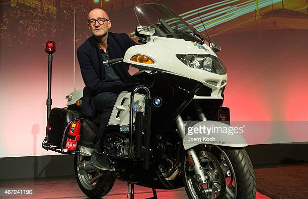 Actor and voiceover artist Peter Lohmeyer poses on a BMW police motorbike prior to a reading of the book 'Verheissung' by Danish author Jussi...