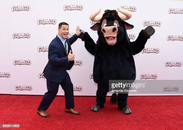 Actor and wrestler John Cena and Ferdinand arrive at a screening of 20th Century Fox's 'Ferdinand' at the Zanuck Theater at 20th Century Fox Lot on...