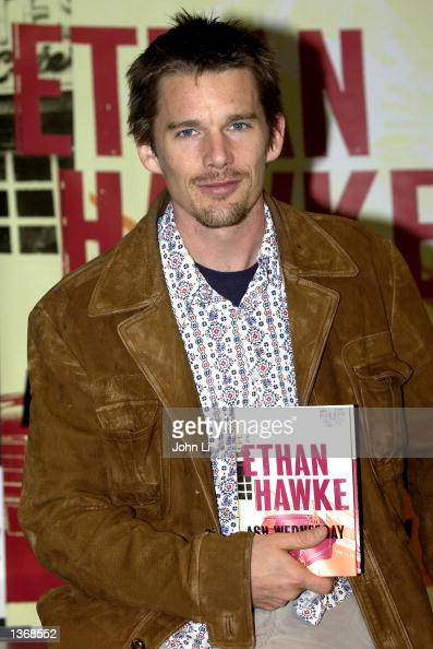 Actor and writer Ethan Hawke holds his new book 'Ash Wednesday' before autographing it at HMV Oxford Street September 5 2002 in London England