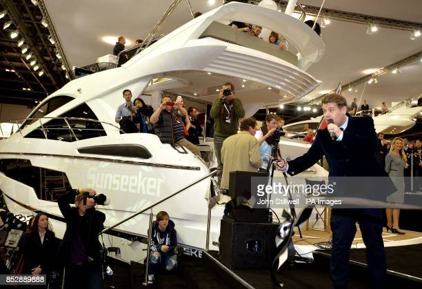 Actor and writer James Corden cuts a ribbon to launch the new British built Sunseeker 75 luxury Yacht on the first day of the London Boat show 2014...
