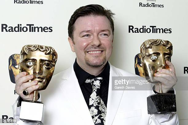 Actor and writer Ricky Gervais poses holding two awards at the British Academy Television Awards held at the London Palladium London on April 13 2003...