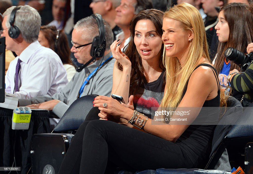 Actor and writer Whitney Cummings and model Beth Ostrosky sit courtisde for the Charlotte Bobcats against the New York Knicks during the game on November 5, 2013 at Madison Square Garden in New York City, New York.
