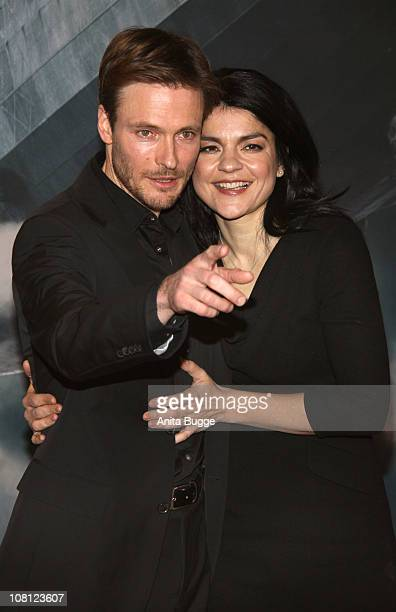 Actor Andreas Pietschmann and actress Jasmin Tabatabai arrive at the Kosmos movie theater for the Hindenburg premiere on January 18 2011 in Berlin...