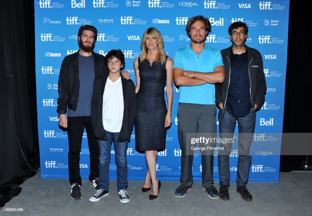 Actor Andrew Garfield actor Noah Lomax actress Laura Dern actor Michael Shannon and director Ramin Bahrani pose at '99 Homes' Press Conference during...
