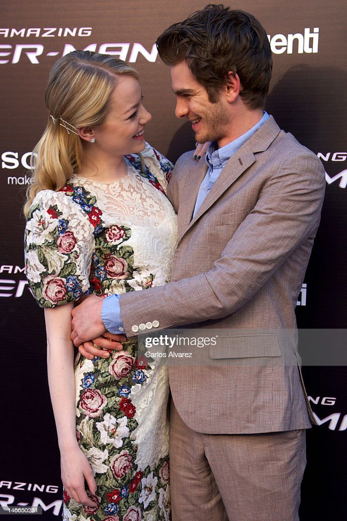 Actor <a gi-track='captionPersonalityLinkClicked' href=/galleries/search?phrase=Andrew+Garfield&family=editorial&specificpeople=4047840 ng-click='$event.stopPropagation()'>Andrew Garfield</a> and actress <a gi-track='captionPersonalityLinkClicked' href=/galleries/search?phrase=Emma+Stone&family=editorial&specificpeople=672023 ng-click='$event.stopPropagation()'>Emma Stone</a> attend 'The Amazing Spider-Man' premiere at Callao cinema on June 21, 2012 in Madrid, Spain.