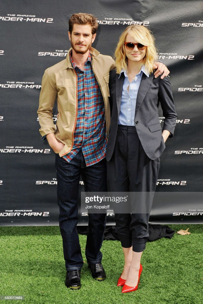 Actor Andrew Garfield and actress Emma Stone pose at 'The Amazing Spiderman 2' - Los Angeles Photo Call at Sony Pictures Studios on November 16, 2013 in Culver City, California.