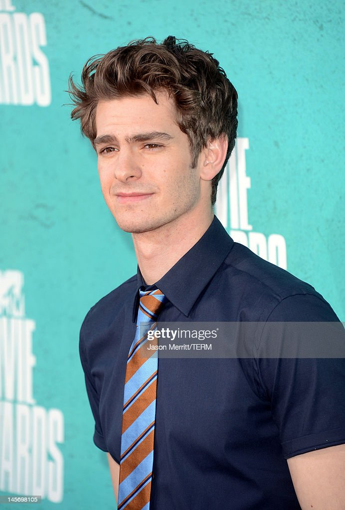 Actor <a gi-track='captionPersonalityLinkClicked' href=/galleries/search?phrase=Andrew+Garfield&family=editorial&specificpeople=4047840 ng-click='$event.stopPropagation()'>Andrew Garfield</a> arrives at the 2012 MTV Movie Awards held at Gibson Amphitheatre on June 3, 2012 in Universal City, California.