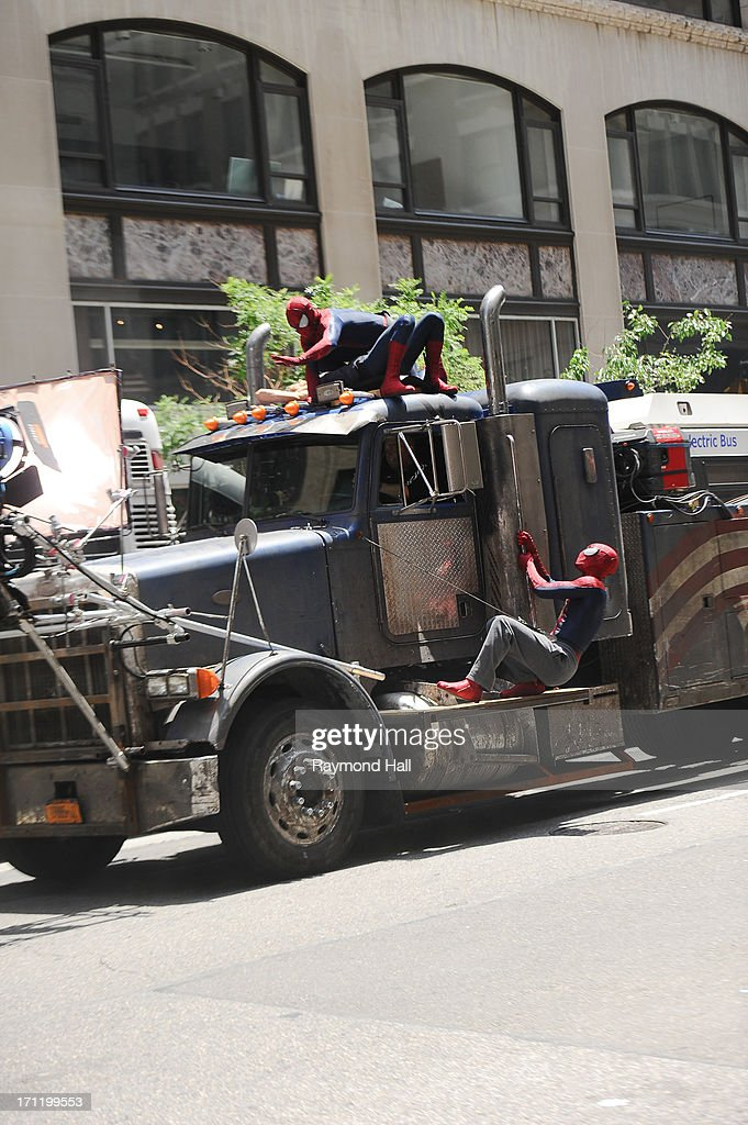 Actor Andrew Garfield (R), his stunt double William Spencer (C) and a second stunt double are seen on set of 'The Amazing Spider-Man 2' on June 22, 2013 in New York City.