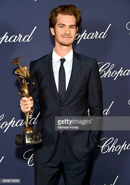 Actor Andrew Garfield poses with the Spotlight Award during the 28th Annual Palm Springs International Film Festival Film Awards Gala at the Palm...
