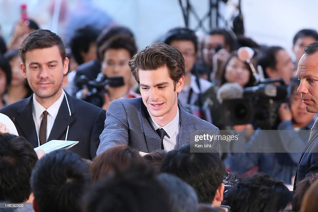 Actor <a gi-track='captionPersonalityLinkClicked' href=/galleries/search?phrase=Andrew+Garfield&family=editorial&specificpeople=4047840 ng-click='$event.stopPropagation()'>Andrew Garfield</a> signs autographs for fans during the world Premiere of 'The Amazing Spider-Man' at Roppongi Hills on June 13, 2012 in Tokyo, Japan. The film will open on June 30 in Japan.