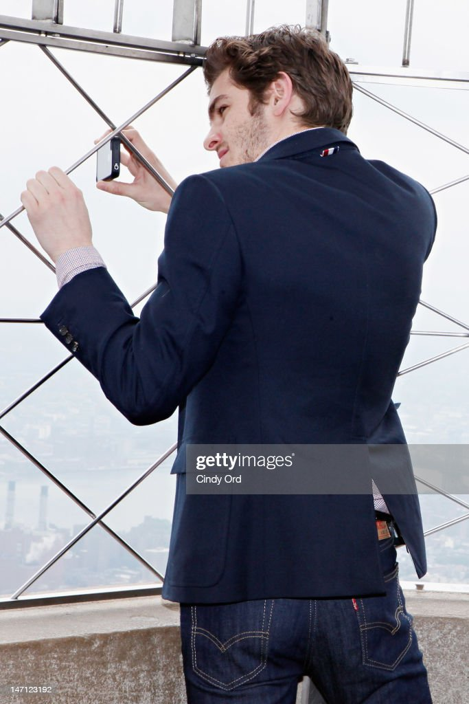 Actor <a gi-track='captionPersonalityLinkClicked' href=/galleries/search?phrase=Andrew+Garfield&family=editorial&specificpeople=4047840 ng-click='$event.stopPropagation()'>Andrew Garfield</a> takes pictures with his i-phone on the observatory deck of The Empire State Building on June 25, 2012 in New York City.