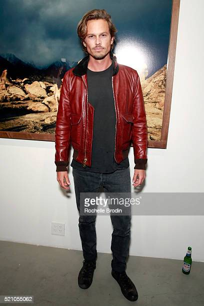 Actor Andrew Gray McDonnell attends the Photo Femmes Exhibition Opening at De Re Gallery featuring the work of Ashley Noelle Bojana Novakovic and...