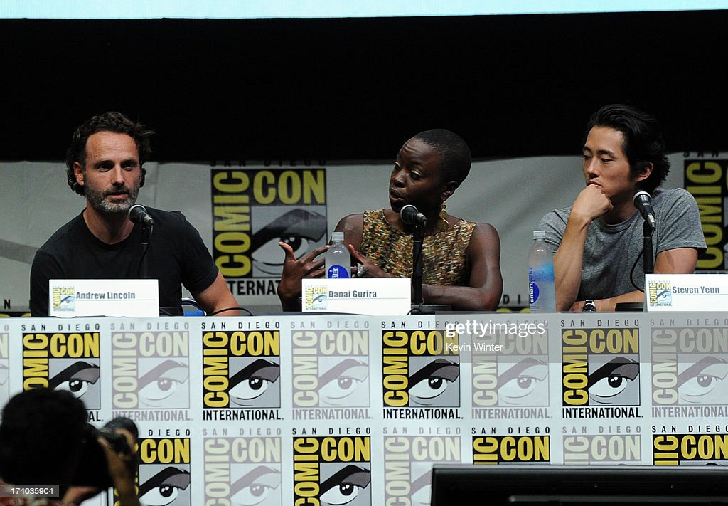 Actor Andrew Lincoln, actress Danai Gurira and actor Steven Yeun speak onstage at AMC's 'The Walking Dead' panel during Comic-Con International 2013 at San Diego Convention Center on July 19, 2013 in San Diego, California.