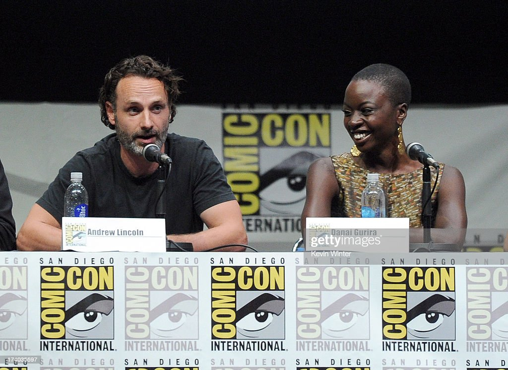 Actor Andrew Lincoln (L) and actress Danai Gurira speak onstage at AMC's 'The Walking Dead' panel during Comic-Con International 2013 at San Diego Convention Center on July 19, 2013 in San Diego, California.