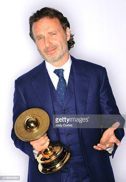 Actor Andrew Lincoln poses with his award for Best Actor on Television in 'The Walking Deadr' at 41st Annual Saturn Awards held at The Castaway on...