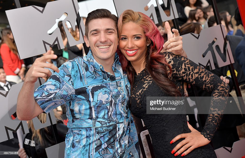 Actor Andrew Schulz (L) and TV personality Nessa attend the 2014 MTV Movie Awards at Nokia Theatre L.A. Live on April 13, 2014 in Los Angeles, California.