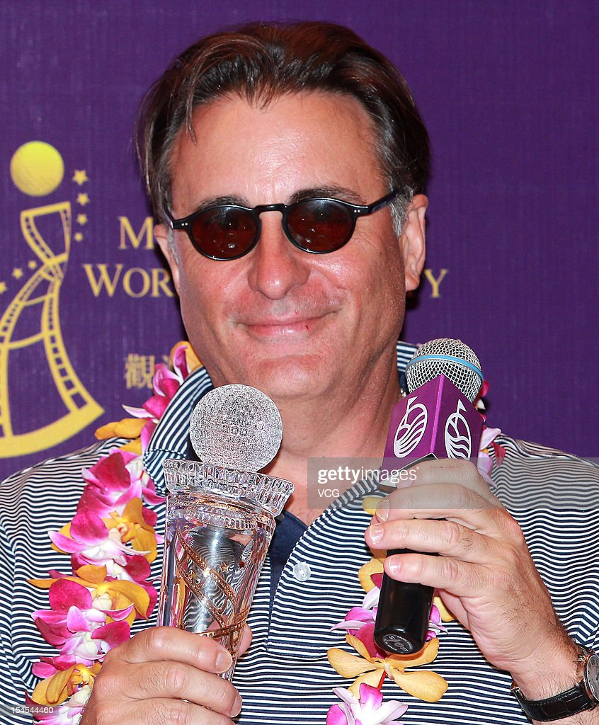 Actor <a gi-track='captionPersonalityLinkClicked' href=/galleries/search?phrase=Andy+Garcia&family=editorial&specificpeople=156410 ng-click='$event.stopPropagation()'>Andy Garcia</a> poses with the trophy after winning the Mission Hills Star Trophy at the Mission Hills Golf Club on October 21, 2012 in Haikou, China.