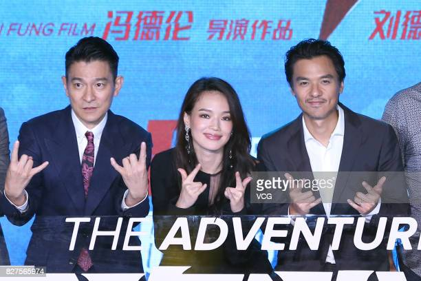 Actor Andy Lau actress Shu Qi and her husband director Stephen Fung attend the premiere of film 'The Adventurers' on August 8 2017 in Beijing China