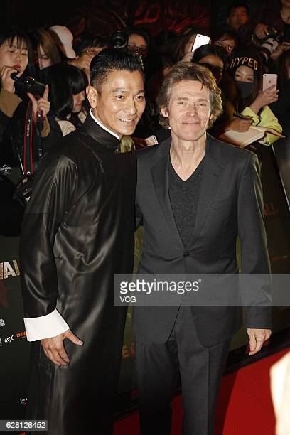 Actor Andy Lau and American actor Willem Dafoe pose on the red carpet during the premiere of director Zhang Yimou's film 'The Great Wall' on December...