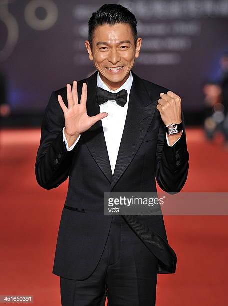 Actor Andy Lau arrives on the red carpet of the 50th Golden Horse Awards at Sun Yatsen Memorial Hall on November 23 2013 in Taipei Taiwan