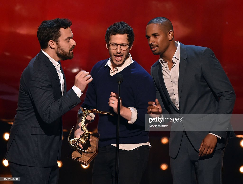 Actor Andy Samberg (C) accepts the Primetime award from Jake Johnson (L) and Damon Wayans Jr. onstage during Spike TV's 'Guys Choice 2014' at Sony Pictures Studios on June 7, 2014 in Culver City, California.