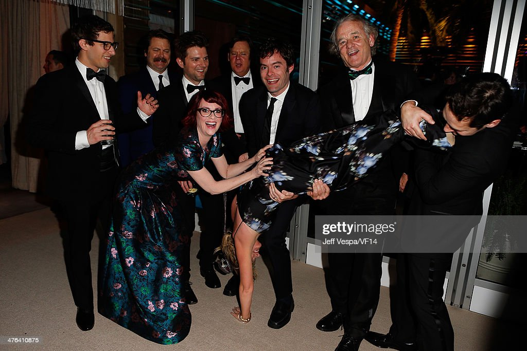 Actor <a gi-track='captionPersonalityLinkClicked' href=/galleries/search?phrase=Andy+Samberg&family=editorial&specificpeople=595651 ng-click='$event.stopPropagation()'>Andy Samberg</a>, <a gi-track='captionPersonalityLinkClicked' href=/galleries/search?phrase=Nick+Offerman&family=editorial&specificpeople=3142027 ng-click='$event.stopPropagation()'>Nick Offerman</a>, Adam Scott, <a gi-track='captionPersonalityLinkClicked' href=/galleries/search?phrase=Megan+Mullally&family=editorial&specificpeople=201612 ng-click='$event.stopPropagation()'>Megan Mullally</a>, Brian Doyle Murray, <a gi-track='captionPersonalityLinkClicked' href=/galleries/search?phrase=Bill+Hader&family=editorial&specificpeople=757145 ng-click='$event.stopPropagation()'>Bill Hader</a>, <a gi-track='captionPersonalityLinkClicked' href=/galleries/search?phrase=Amy+Poehler&family=editorial&specificpeople=228430 ng-click='$event.stopPropagation()'>Amy Poehler</a> (performing handstand), <a gi-track='captionPersonalityLinkClicked' href=/galleries/search?phrase=Bill+Murray&family=editorial&specificpeople=171116 ng-click='$event.stopPropagation()'>Bill Murray</a>, and <a gi-track='captionPersonalityLinkClicked' href=/galleries/search?phrase=Paul+Rudd&family=editorial&specificpeople=209014 ng-click='$event.stopPropagation()'>Paul Rudd</a> attend the 2014 Vanity Fair Oscar Party Hosted By Graydon Carter on March 2, 2014 in West Hollywood, California.