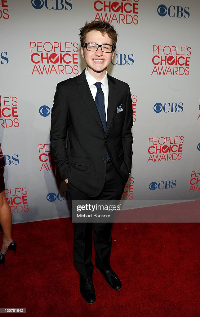 Actor <a gi-track='captionPersonalityLinkClicked' href=/galleries/search?phrase=Angus+T.+Jones&family=editorial&specificpeople=240423 ng-click='$event.stopPropagation()'>Angus T. Jones</a> arrives at the 2012 People's Choice Awards at Nokia Theatre L.A. Live on January 11, 2012 in Los Angeles, California.