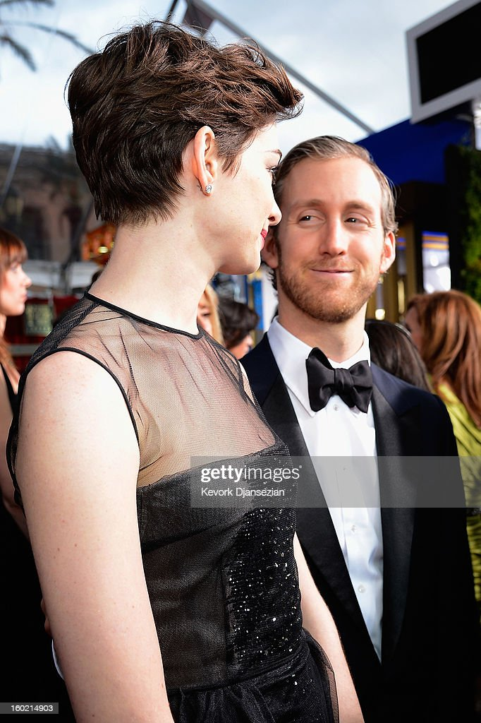 Actor Anne Hathaway and Adam Shulman arrives at the 19th Annual Screen Actors Guild Awards held at The Shrine Auditorium on January 27, 2013 in Los Angeles, California.