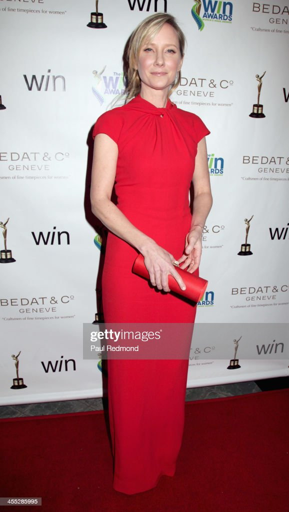 Actor <a gi-track='captionPersonalityLinkClicked' href=/galleries/search?phrase=Anne+Heche&family=editorial&specificpeople=202988 ng-click='$event.stopPropagation()'>Anne Heche</a> arrives at The Annual Women's Image Awards at Santa Monica Bay Woman's Club on December 11, 2013 in Santa Monica, California.