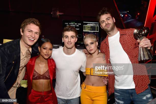 Actor Ansel Elgort and model Karrueche Tran poses backstage with DJs Drew Taggart and Alex Pall of The Chainsmokers and singer Halsey winners of...