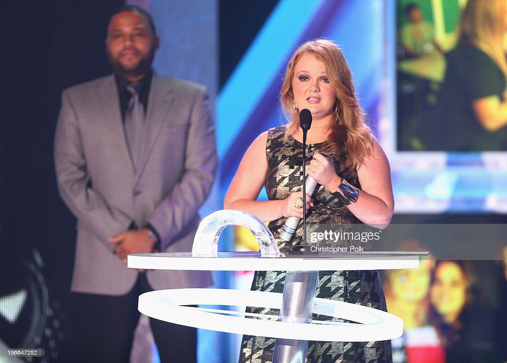 Actor Anthony Anderson( L) and 2012 HALO Award Nominee Taylor Waters speak on stage at Nickelodeon's 2012 TeenNick HALO Awards at Hollywood Palladium on November 17, 2012 in Hollywood, California. The show premieres on Monday, November 19th, 8:00p.m. (ET) on Nick at Nite.