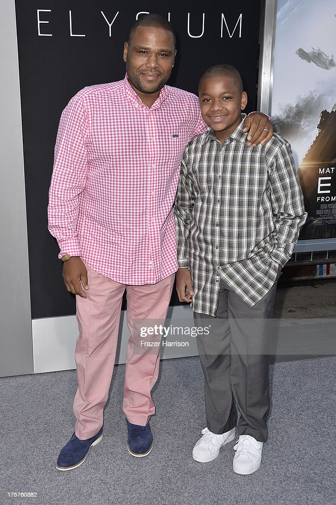 Actor Anthony Anderson and his son Nathan arrive at the premiere of TriStar Pictures' 'Elysium' at Regency Village Theatre on August 7, 2013 in Westwood, California.