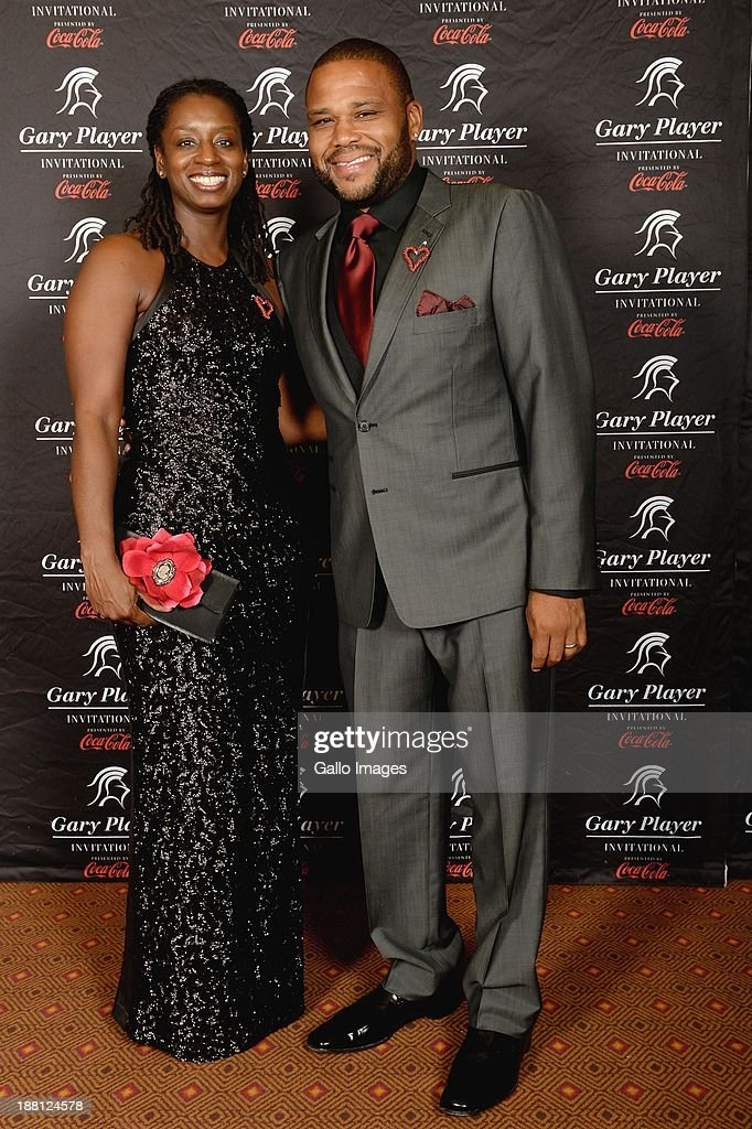 Actor <a gi-track='captionPersonalityLinkClicked' href=/galleries/search?phrase=Anthony+Anderson&family=editorial&specificpeople=202577 ng-click='$event.stopPropagation()'>Anthony Anderson</a> (R) and his wife attend the Gala Dinner and Charitable Auction of the Gary Player Invitational presented by Coca-Cola at Sun City Convention Centre on November 15, 2013 in Sun City, South Africa.