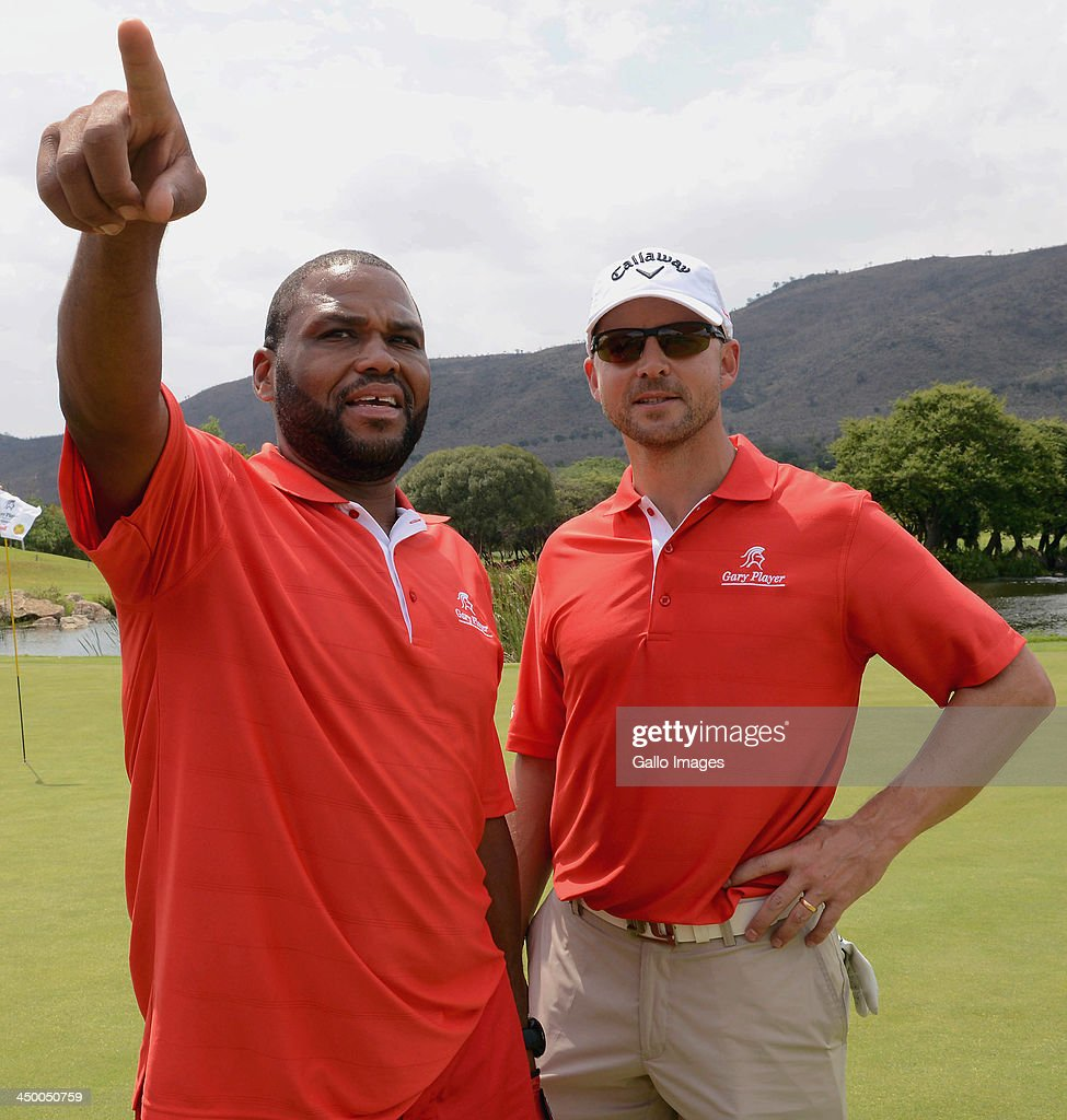 Actor Anthony Anderson (L) and Professional Golfer Niclas Fasth take part in Round 1 of the Gary Player Invitational presented by Coca-Cola at The Lost City Golf Course on November 16, 2013 in Sun City, South Africa.