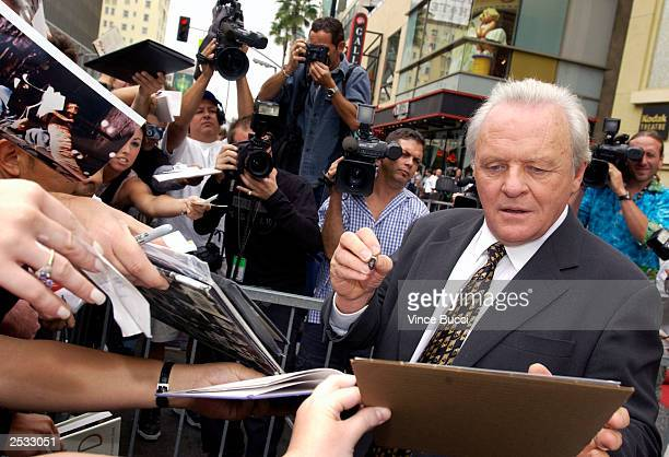Actor Anthony Hopkins signs autographs at a ceremony honoring him with a star on the Hollywood Walk of Fame on September 24 2003 in Hollywood...
