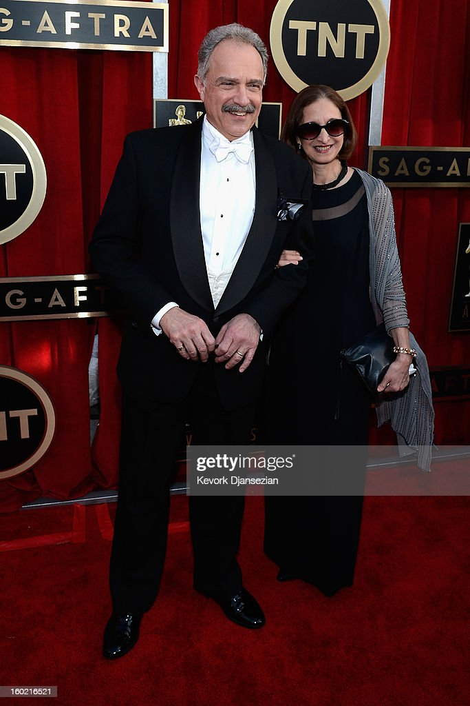 Actor Anthony Laciura (L) and wife Joel Laciura arrives at the 19th Annual Screen Actors Guild Awards held at The Shrine Auditorium on January 27, 2013 in Los Angeles, California.