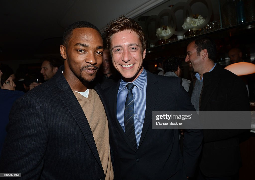 Actor <a gi-track='captionPersonalityLinkClicked' href=/galleries/search?phrase=Anthony+Mackie&family=editorial&specificpeople=206212 ng-click='$event.stopPropagation()'>Anthony Mackie</a> (L) and guest attend the Audi Golden Globes Kick Off 2013 at Cecconi's Restaurant on January 6, 2013 in Los Angeles, California.
