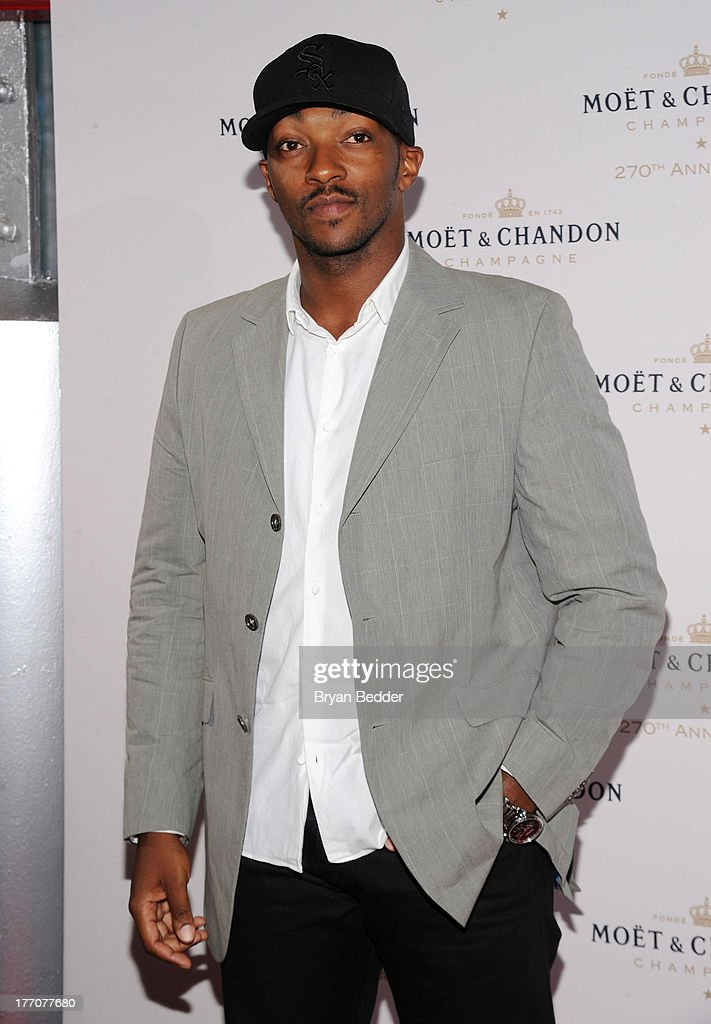 Actor <a gi-track='captionPersonalityLinkClicked' href=/galleries/search?phrase=Anthony+Mackie&family=editorial&specificpeople=206212 ng-click='$event.stopPropagation()'>Anthony Mackie</a> attends Moet & Chandon Celebrates Its 270th Anniversary With New Global Brand Ambassador, International Tennis Champion, Roger Federer at Chelsea Piers Sports Center on August 20, 2013 in New York City.