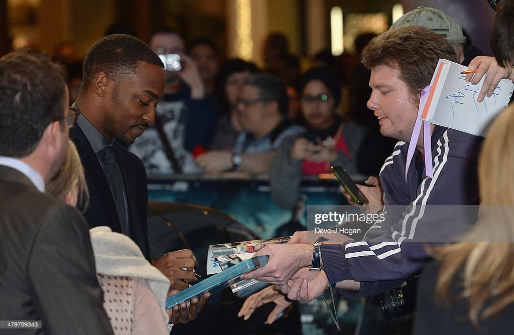 Actor Anthony Mackie signs autographs as he attends the 'Captain America: The Winter Soldier' UK film premiere at Westfield on March 20, 2014 in London, England.