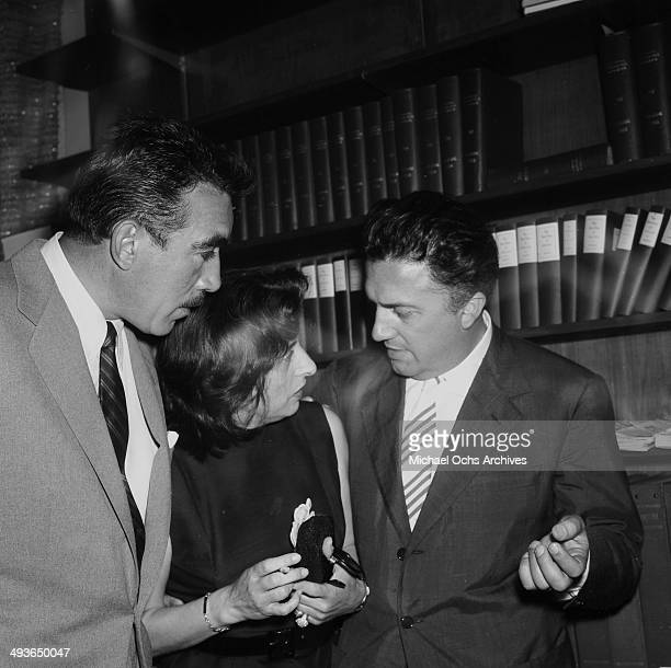 Actor Anthony Quinn with Director Federico Fellini at his cocktail party in Los Angeles California