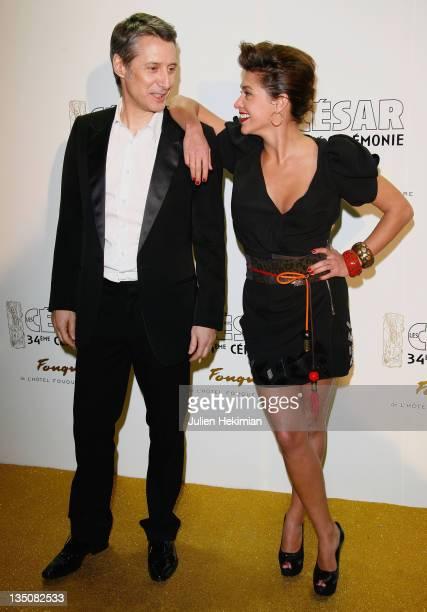 Actor Antoine de Caunes and daughter Emma de Caunes arrive at the Cesar Film Awards 2009 after party at Fouquet's on February 27 2009 in Paris France