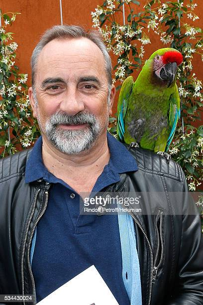 Actor Antoine Dulery and parrot Zoe attend the 2016 French Tennis Open Day Four at Roland Garros on May 25 2016 in Paris France