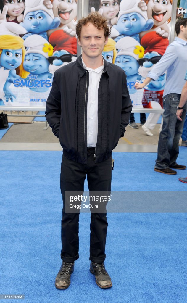 Actor Anton Yelchin arrives at the Los Angeles premiere of 'Smurfs 2' at Regency Village Theatre on July 28, 2013 in Westwood, California.