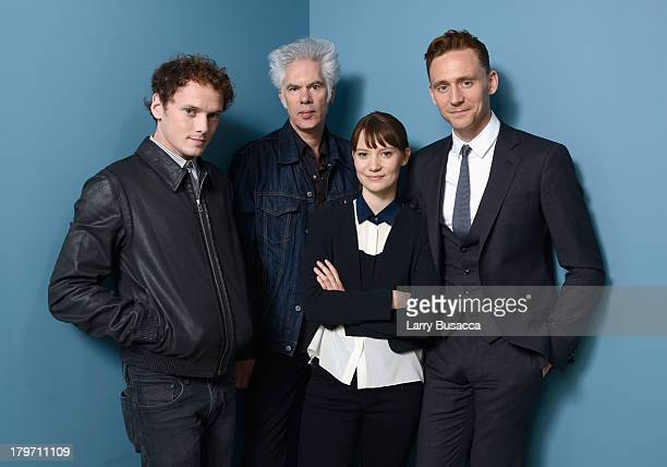 Actor Anton Yelchin director Jim Jarmusch actress Mia Wasikowska and Tom Hiddleston of 'Only Lovers Left Alive' pose at the Guess Portrait Studio...
