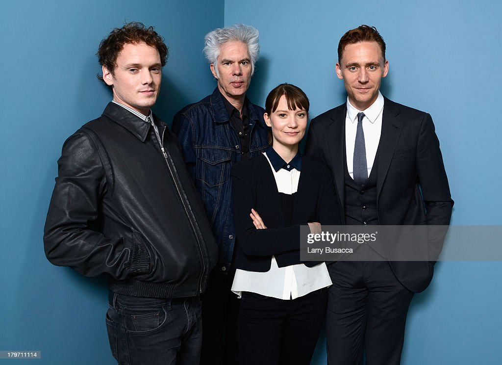 Actor Anton Yelchin, director Jim Jarmusch, actress Mia Wasikowska and Tom Hiddleston of 'Only Lovers Left Alive' pose at the Guess Portrait Studio during 2013 Toronto International Film Festival on September 6, 2013 in Toronto, Canada.